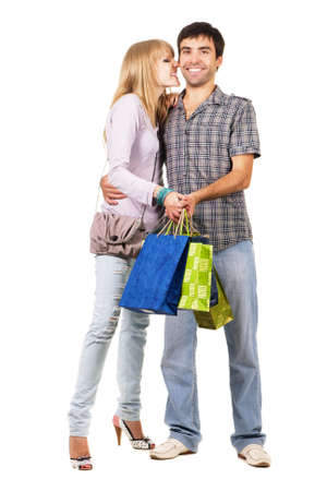 Beautiful young couple with shopping bags, isolated on white background Stock Photo - 7092291