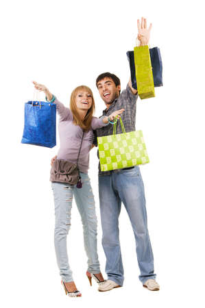 Beautiful young couple with shopping bags, isolated on white background Stock Photo - 7092280