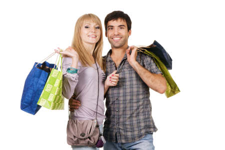 a pair: Beautiful young couple with shopping bags, isolated on white background Stock Photo