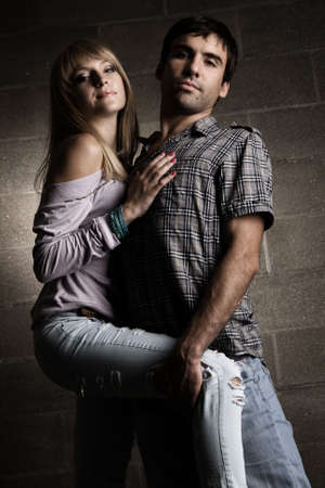Young cheerful couple on brick wall background photo