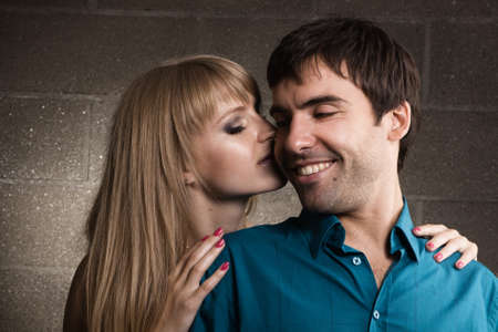 Young romantic couple kissing in house inter Stock Photo - 7143232