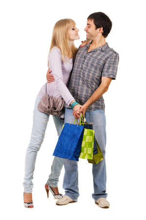 Beautiful young couple with shopping bags, isolated on white background Stock Photo - 7154509