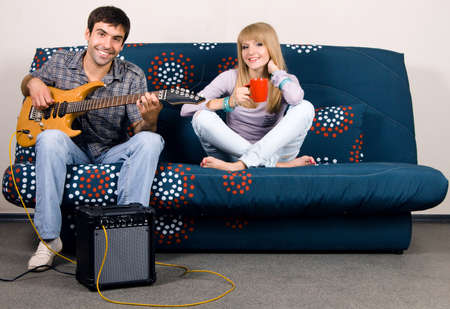 Cheerful couple resting on a sofa photo