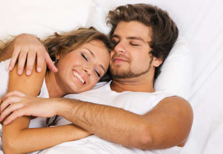 lovers in bed: Young beautiful couple sleeping in bed