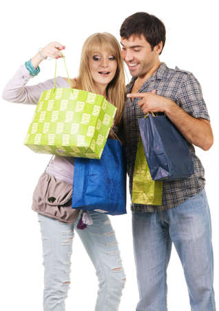 Beautiful young couple with shopping bags, isolated on white background photo