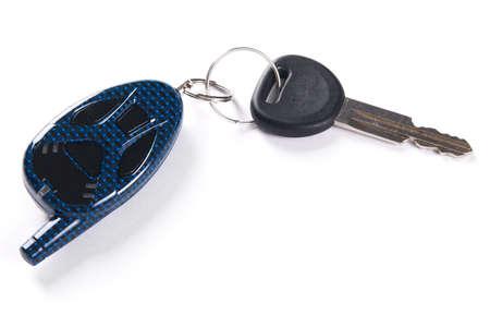 Car keys with alarm system, white background photo