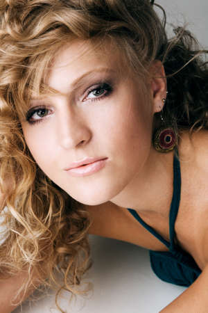 Portrait of a beautiful elegant blonde with curly hair  photo