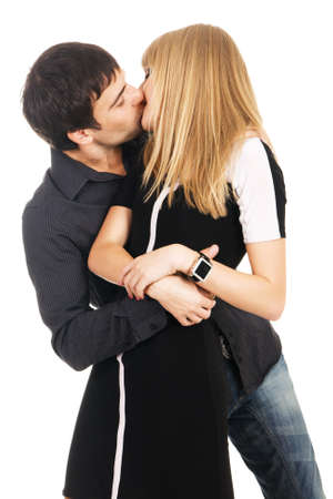 female sexuality: Young elegant couple is kissing against white background