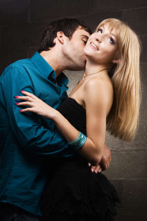 Young romantic couple kissing in house interior  photo