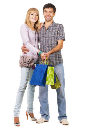 Beautiful young couple with shopping bags, isolated on white background Stock Photo - 7564095
