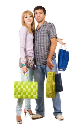 Beautiful young couple with shopping bags, isolated on white background  Stock Photo - 7805803