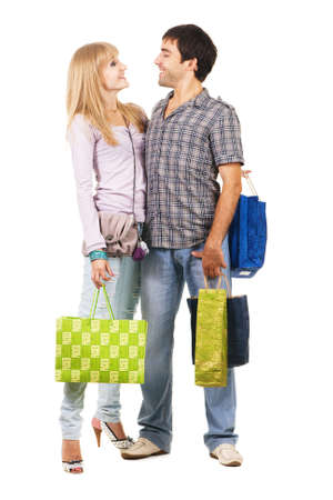 Beautiful young couple with shopping bags, isolated on white background Stock Photo - 7805809