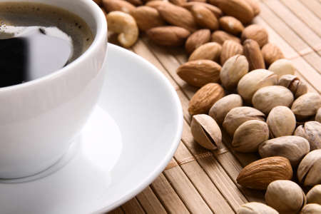 Delicious coffee with nuts on the background  photo