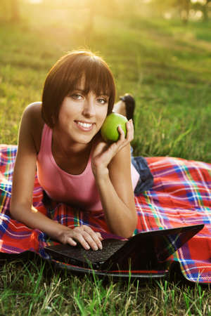 Lovely girl having a rest with laptop on picnic Stock Photo - 7805816