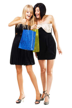 Pretty girls with shopping bags, isolated on white photo