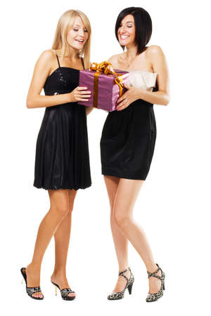 Pretty festive girls with a gift box, isolated on white photo