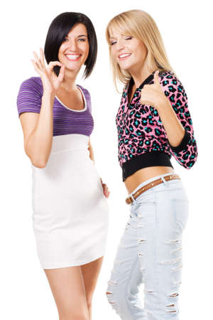 Two young beautiful woman showing