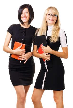 Two elegant businesswomen against white background Stock Photo - 7849883