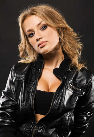 Portrait of a beautiful sexy woman in black leather jacket Stock Photo - 7849904