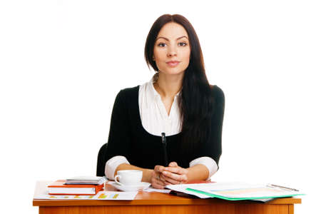 Charming young businesswoman, working in her office  photo