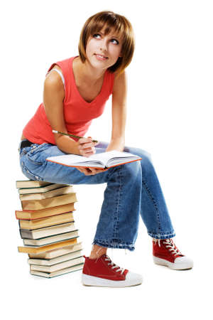 Lovely student with a lot of books, isolated on white Stock Photo - 7849882