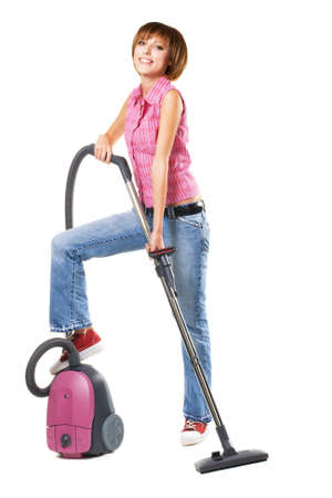 Young cheerful woman with vacuum cleaner, isolated on white  photo
