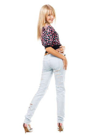 Pretty blonde in blue jeans against white background photo