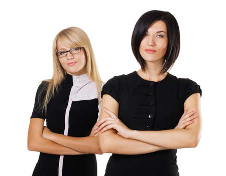 Two beautiful businesswoman against white background photo