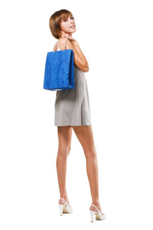 Lovely girl with shopping bag, isolated on white  photo