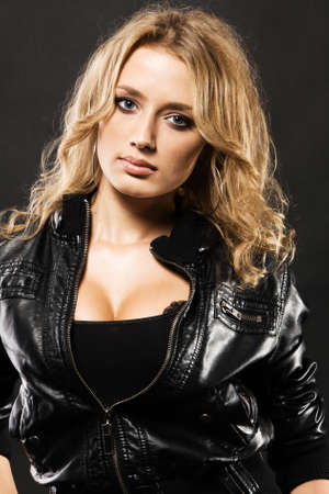 Portrait of a beautiful sexy woman in black leather jacket photo