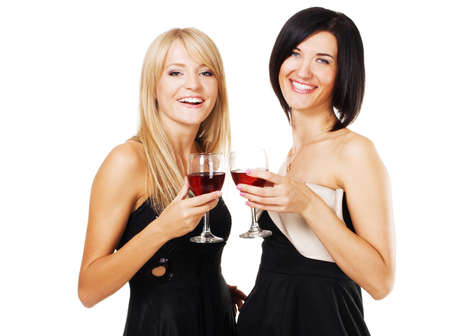 Two pretty cheerful women with glasses of wine, white bzckground photo