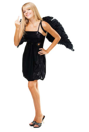 fuck: Pretty girl with black wings showing  Stock Photo