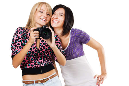 Two lovely friends with a camera, white background photo