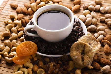 Coffee with nuts, fig and dried apricots still life  photo