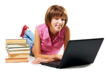 Cheerful girl with laptop and stack of books, white background Stock Photo - 7952327