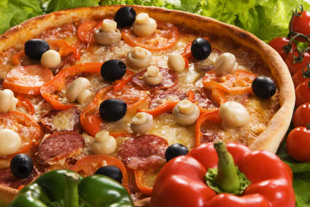 Closeup picture of a pizza with vegetables  photo
