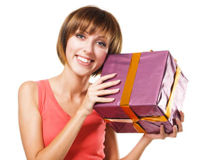 Lovely girl with a gift box, white background photo
