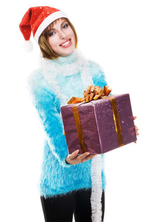 Lovely girl with Christmas gift against white background photo