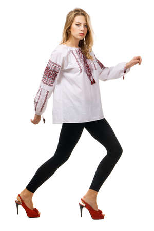 Fashionable model in a traditional slavic shirt, white background photo