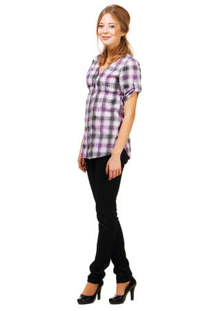 Lovely young woman in casual clothing, white background   photo