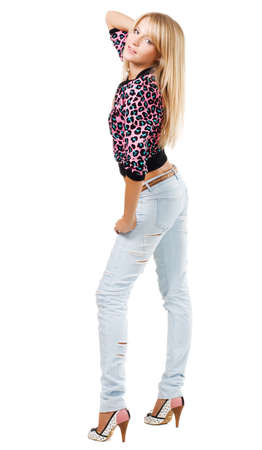 lacerated: Pretty blonde in blue jeans against white background