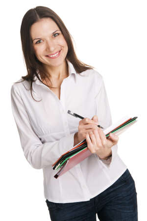 Young businesswoman with a bunch of documents writing at note pad, white background  photo