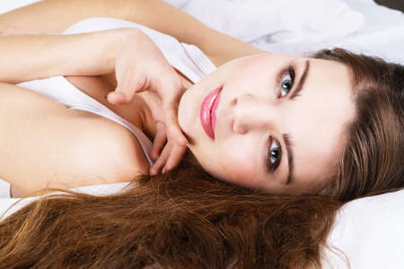 Young beautiful woman lying in bed photo