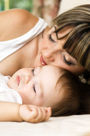 Lovely mother with her little daughter sleeping in the bed Stock Photo - 8653428