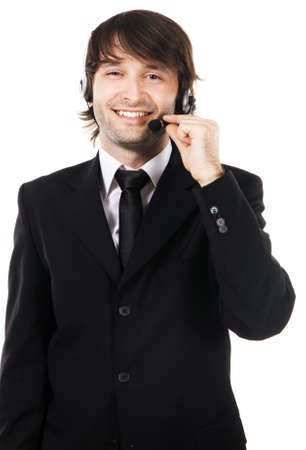 Portrait of a happy young businessman with headset on white background  photo