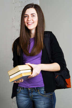 Portrait of a lovely student girl with books photo