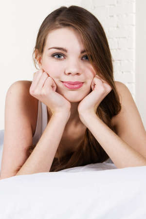 Young beautiful woman lying in bed Stock Photo - 8653470