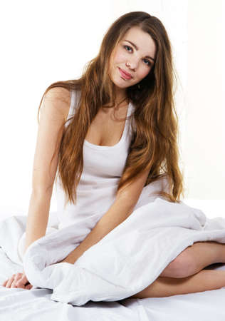 Young beautiful woman lying in bed Stock Photo - 8653472
