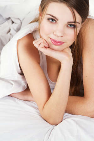 Young beautiful woman lying in bed  Stock Photo - 8686069