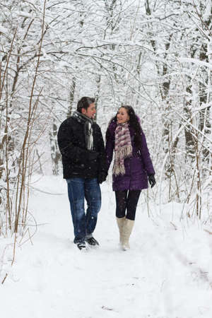 couple winter: Young happy couple walking in winter park